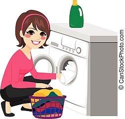 Woman Washing Machine - Beautiful young woman doing laundry...