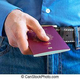 Man showing his european passport at airport.
