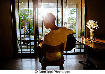 asian artist man play guitar in cafe sunlight - asian artist...