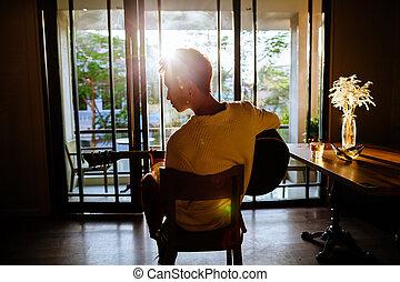 asian artist man play guitar in cafe sunlight - asian artist...