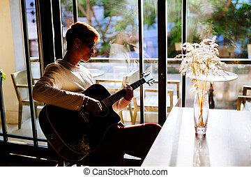asian artist man play guitar in cafe - asian artist man play...