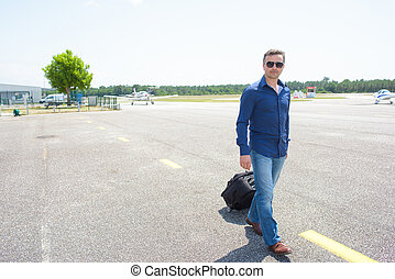 Man with suitcase at airport