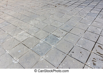 patterned paving tiles, dirty cement brick floor background,