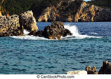 Ionian seaside - rocks surrounded by clear blue Ionian sea...