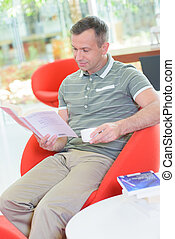 Man at home reading