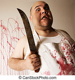 Mad butcher with knife - Crazy insane butcher covered with...