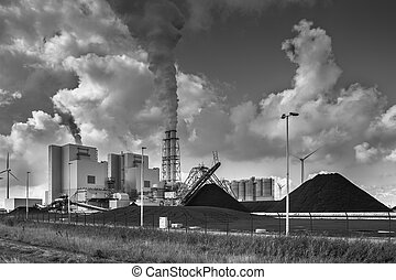 Heavy industrial plant with pipes and smoke