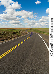 Paved Two Lane Road Highway Transportation White Clouds Blue Skky