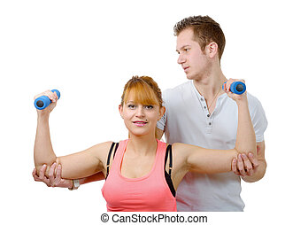 young woman doing stretching exercises with coach
