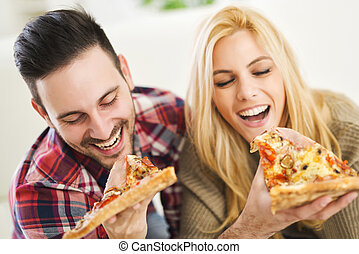 Pizza time - Portrait of an happy couple