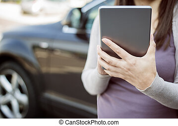 Car insurance - Woman using digital tablet and call the car...
