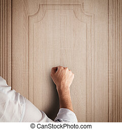 Knock door - Business man knocks to a wooden door