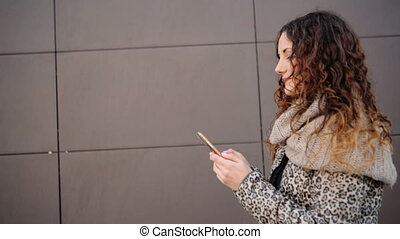 Attractive woman chatting with her friends in the street.