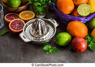 Juicer with different citrus fruits