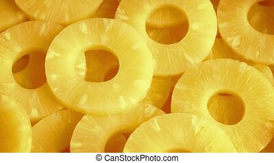 Juicy Pineapple Rings Rotating - Juicy yellow pineapple...