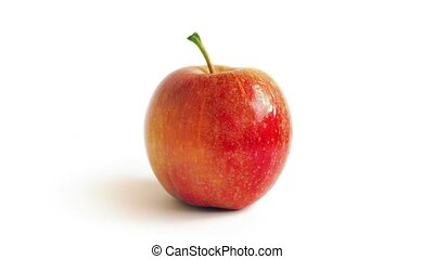 Red Apple Rotating On White - Red apple turns against plain...