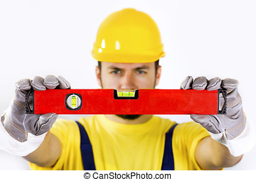 quality control - construction worker with spirit level