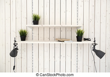 adjustable shelves on wooden plank wall