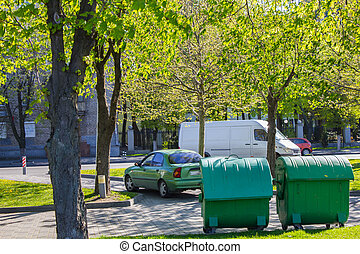 Plastic waste container - Green garbage cans on the street...