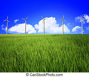 wind turbine and landscape - green grass field and blue...