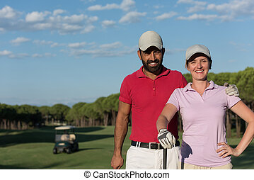 portrait of couple on golf course