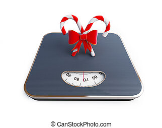 candy on the scale on a white background