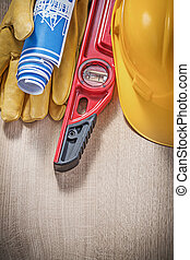 Composition of building tools on wooden board construction...
