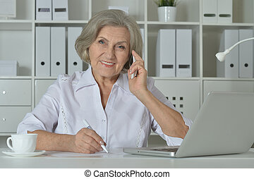Elderly woman working on laptop - happy Elderly woman...