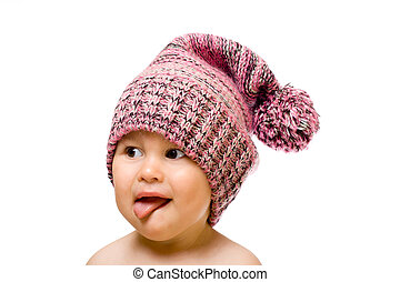 Cute little child - Happy child in hat smiling, sticking his...