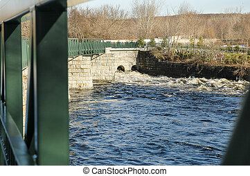 Water moving along Blackstone River - Water races under...