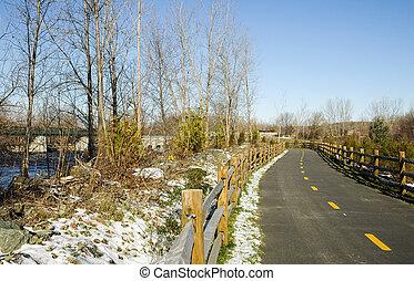 Bike path curving toward bridge - Blackstone River Bikeway...