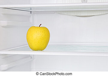 Lifestile conceptYellow apple in domestic refrigerator -...