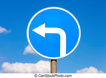 Road sign Turn left against the blue sky