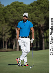 golf player portrait at course - handsome middle eastern...