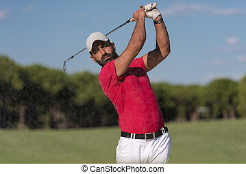 golfer hitting a sand bunker shot - golf player shot ball...