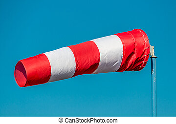 windsock against blue sky - a windsock inflated by the wind....
