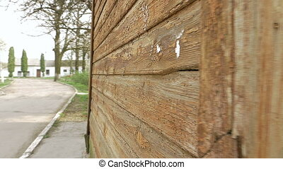 Old house wooden walls rich texture tracking shot - Old...