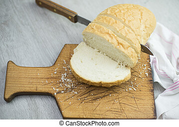 Bread - Slice of bread with knife on cutting board