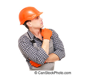 Builder in the construction overalls and helmet