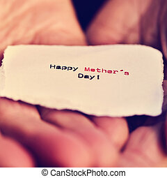 piece of paper with text happy mothers day - closeup of a...