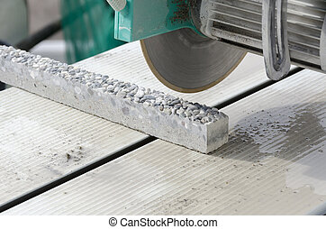cutting a tile - water saw for tiles on a building site