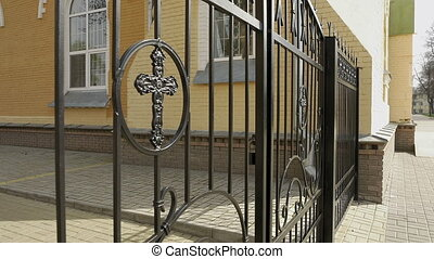 Metal fence and gate with cross of the churchyard - Metal...