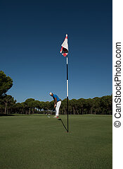 golf player hitting shot at sunny day - golf player hitting...