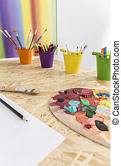 Time spent creatively - Shot of a desk with paints, crayons...