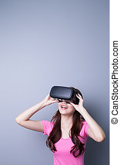 woman using VR headset glasses - Smile happy woman getting...