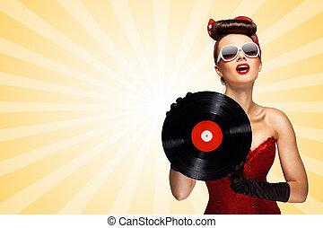 Retro play. - Vintage photo of glamorous pinup girl wearing...