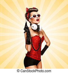 Pin-up party. - Retro photo of a glamorous pin-up girl with...