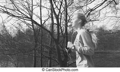 Runner woman running in park exercising outdoors fitness