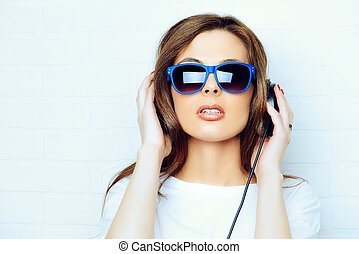 music generation - Modern young woman enjoys the music on...