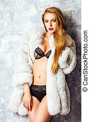 sexy woman in fur coat - Gorgeous blonde woman posing in...